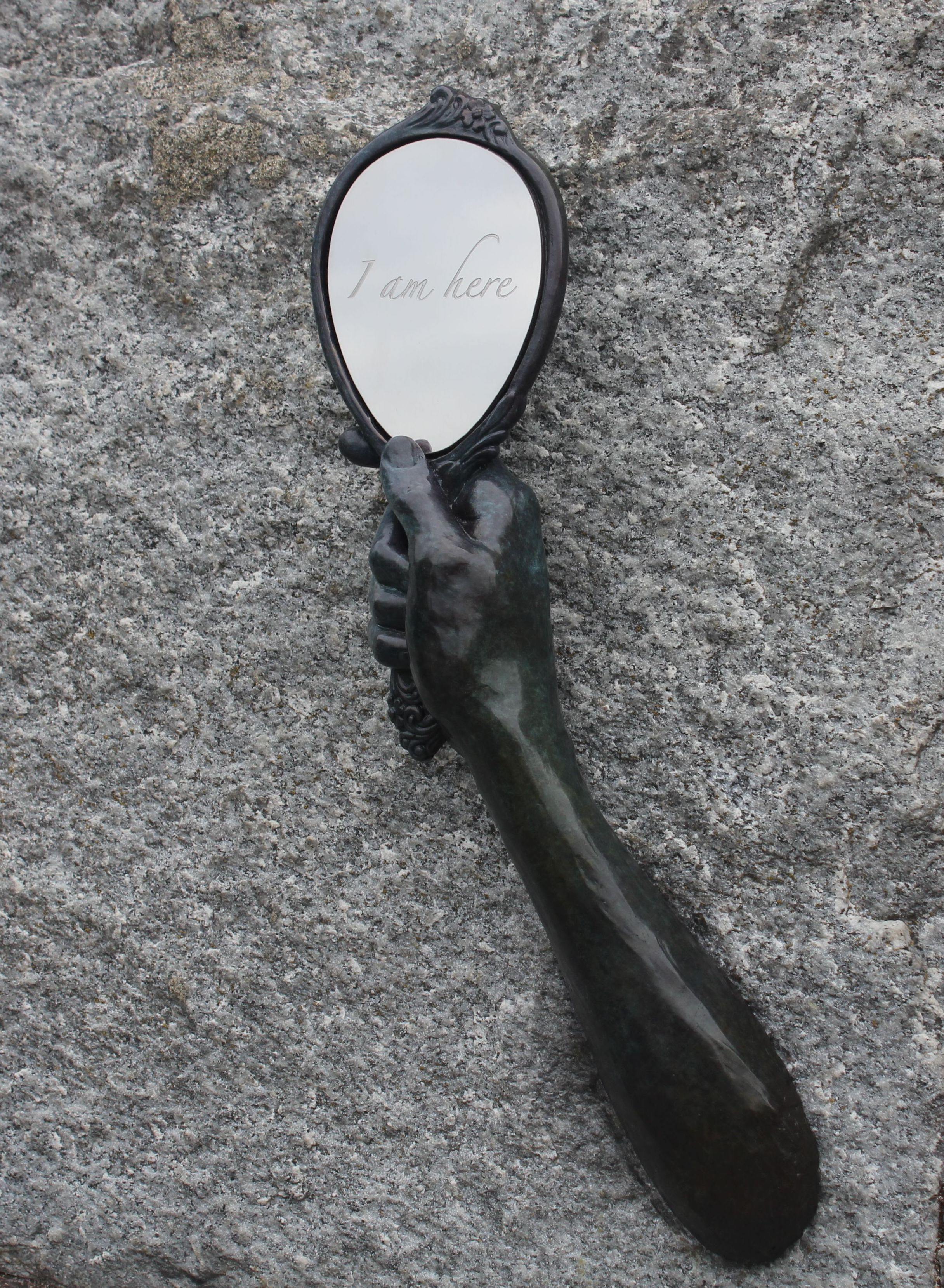 hand holding mirror. discover \ hand holding mirror l